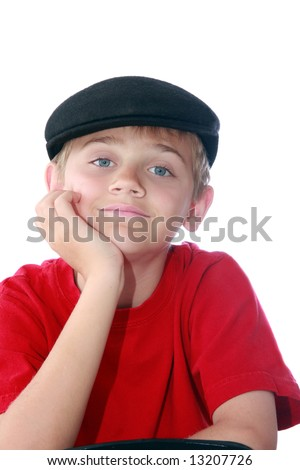 cute young tween boy wearing paperboy cap and red shirt, isolated on white.