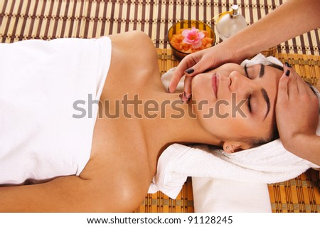 cute young woman lying at spa massage