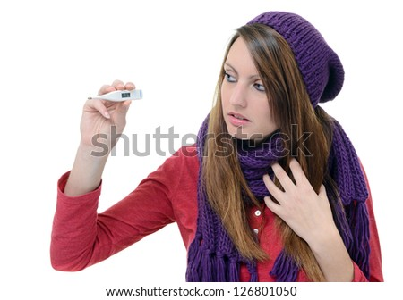 Cute young woman monitor her temperature with thermometer