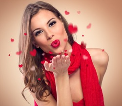 cute young woman to blow kisses