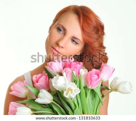 cute young woman with tulips