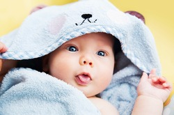 Cutest baby child after bath with towel on head. Adorable baby boy!