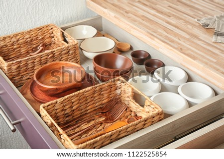 Cutlery and dishware in kitchen drawer