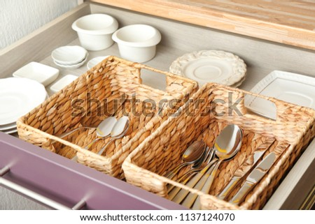 Cutlery and dishware in kitchen drawer #1137124070