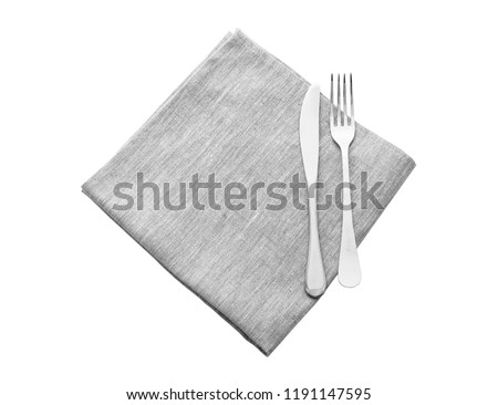 cutlery and napkin icloseup solated on white. Mock up napkins for design. Napkins top view square.