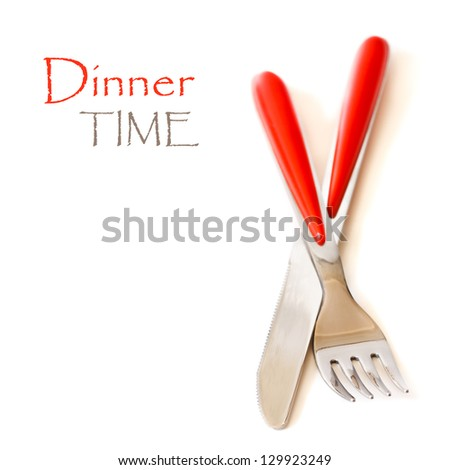 Cutlery set with fork and knife on a white background.