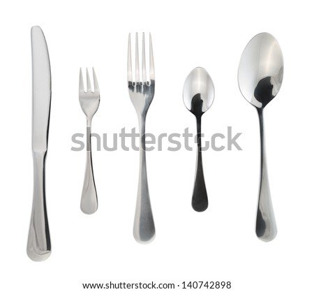 Cutlery silverware or flatware set of forks, spoons and knife isolated over white background