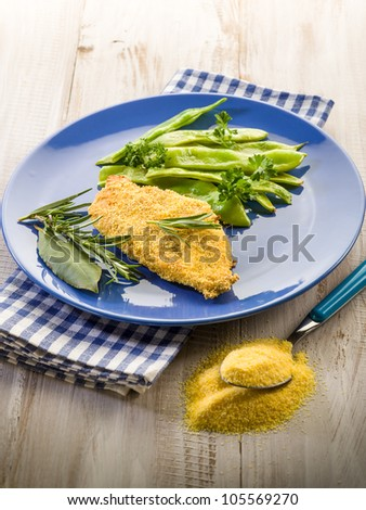 cutlet breaded with maize flour and flat green beans