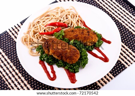 Cutlet with spaghetti on a plate and bamboo mat