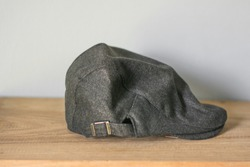 Cutout of a gray tweed hunting hat or flat cap