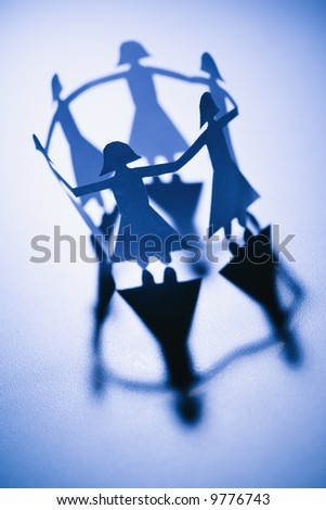 People Holding Hands Paper Cut Out. stock photo : Cutout paper