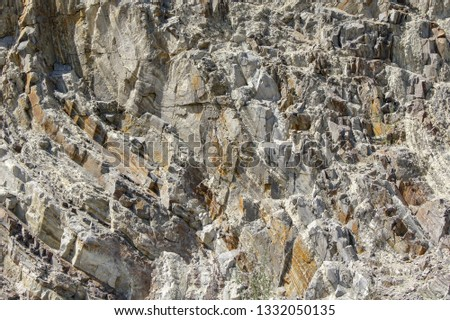 Cuts of stone layers in the quarry. #1332050135