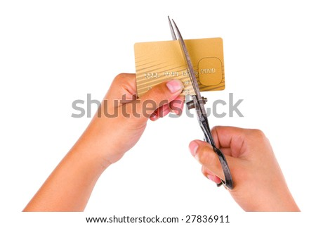 Cutting a gold credit card using a scissor, shot against very bright white background. Identification name has been removed and number has been scrambled. - stock photo