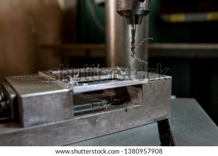 Cutting a screw with a tapping machine #1380957908