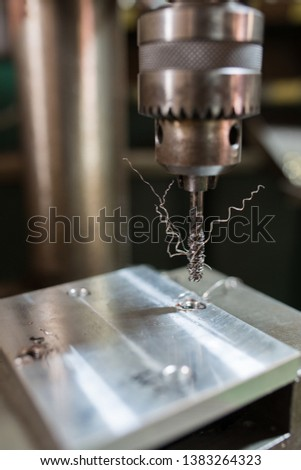 Cutting a screw with a tapping machine #1383264323