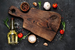 Cutting board and spices for cooking on a stone background