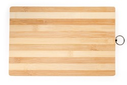 Cutting board made of glued pieces of natural bamboo wood rectangular shape with metal ring for hanging on a white background, top view