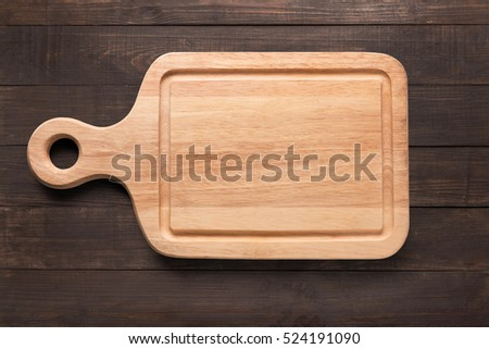 Cutting board on the wooden background. Copy space for your text. #524191090