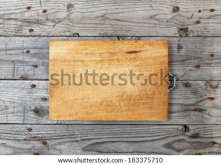 cutting board placed on wooden boards aged