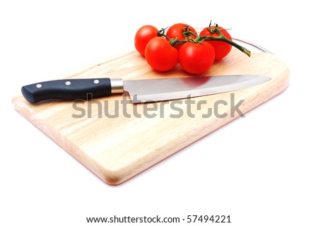 cutting board with a knife and tomato isolated on a white background