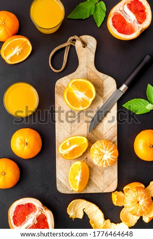 Cutting board with citrus fruits top view