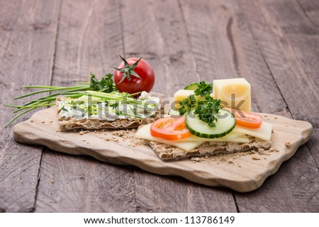 Cutting board with Crispbreads and fresh Herbs