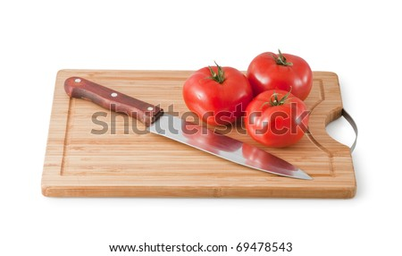 Cutting board with three tomatoes isolated on white a white background