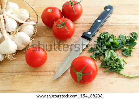 cutting board with tomatoes and knife