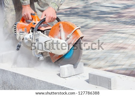 Cutting concrete paving stabs or metal using a cut-off saw