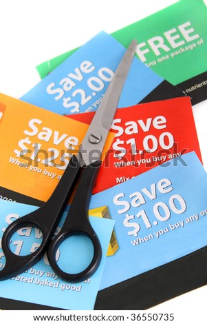 Cutting coupons in different colors, and price ranges from free to a few dollars (short depth of field)
