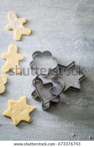 Cutting from fresh dough traditionally butter cookies #673376743