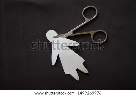 Photo of  Cutting head of paper person. Murder concept