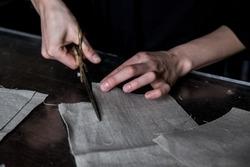 Cutting linen fabric using brass scissors