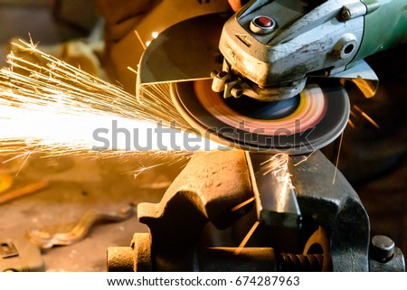 Cutting metal grinding machine, spark. #674287963