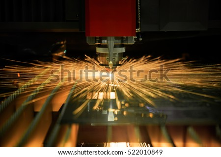 Cutting of sheet metal process with safety glass protection. Sparks fly from laser by automatic cutting CNC, PLC machine. fabricate work, factory, production