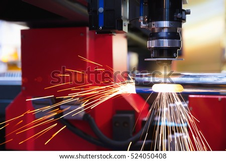 Cutting of sheet metal. Sparks fly from laser by automatic cutting CNC, PLC machine. fabricate work, factory, production #524050408