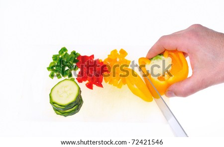 Cutting peppers in the kitchen.