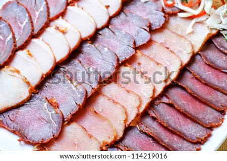 Cutting sausage and meat