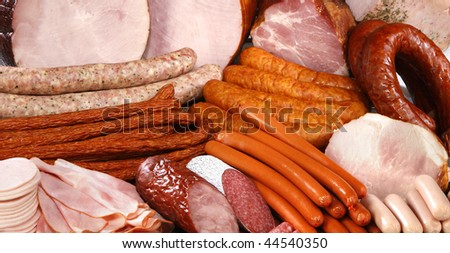 Cutting sausage and meat on a celebratory table.