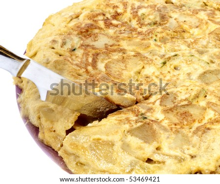 Cutting spanish omelet isolated in white