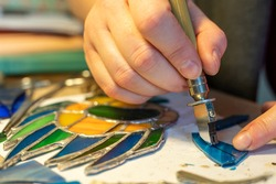 cutting stained glass with a glass cutter, glass scraps, stained glass crafting