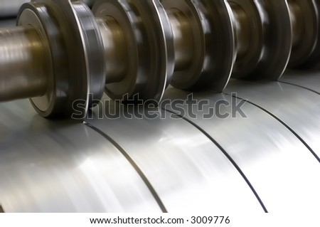 cutting steel machine in a factory - stock photo