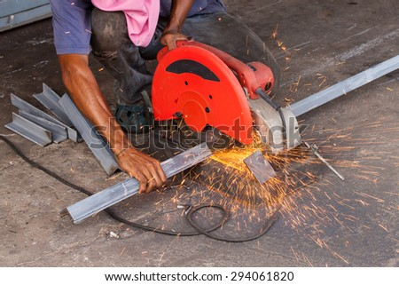 Cutting steel with on protection, hand cutting, work  and safety concept