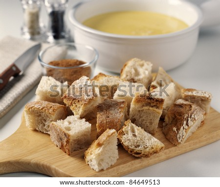 Cutting the bread - stock photo