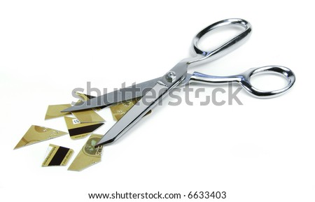 Cutting up a credit card with scissors.