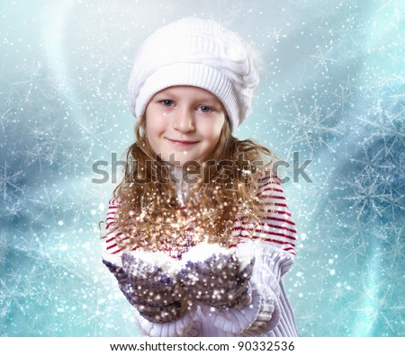Cuty little girl in winter wear happy about new year