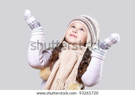Cuty little girl in winter wear happy about new year - stock photo