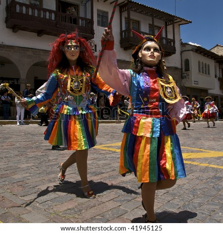 CUZCO, PERU - OCTOBER 8: Women in colorful traditional dresses and masks dance in the Virgen del Rosario Festival near the Plaza de Armas in Cuzco, Peru on October 8, 2009