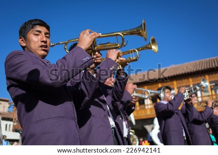 CUZCO, PERU - SEPTEMBER 7: Unknown musicians of a brass band on parade in Cuzco, Peru, 7 Septiembre 2014. Every year in Cuzco passes many religious holidays and carnivals