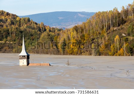 Cyanide and cooper polluted lake in the colorful autumn landscape, Submerged church #731586631